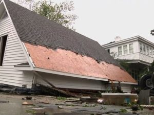 A damaged home with shingles missing from the roof in the aftermath of Hurricane Florence   New Bern, North Carolina