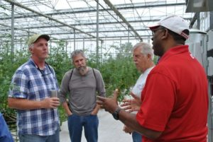 farm school studens in high tunnel